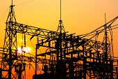 stock photo of hazard  - High voltage power plant and transformation station at sunset - JPG