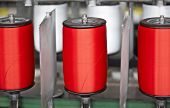 picture of rayon  - Colorful spools of thread in a textile factory - JPG