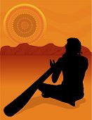 stock photo of didgeridoo  - Black silhouette of an aboriginal in the Australian outback - JPG