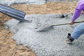stock photo of concrete pouring  - Concrete pouring during commercial concreting floors of buildings in construction - JPG