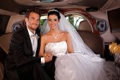 foto of fondling  - Bride and groom sitting happily in limo on wedding - JPG