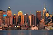 New York City Manhattan sunset panorama with historical skyscrapers over Hudson River with beautiful