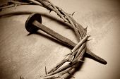 stock photo of christianity  - closeup of a representation of the Jesus Christ crown of thorns and nail - JPG