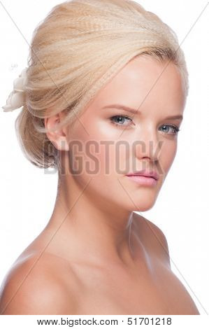 Portrait of pretty young woman with beautiful bridal makeup and hairstyle. Isolated on white background