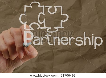 Hand Drawing Partnership Puzzle With Crumpled Recycle Paper Background