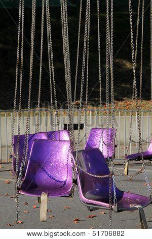 Empty seats on carnival ride