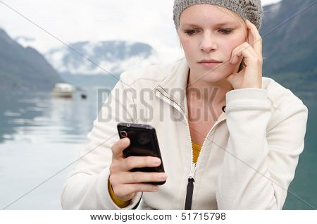 Have Young Blond Woman With Her Smartphone In The Hand