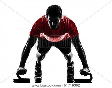 one  man exercising fitness workout push ups  in silhouette  on white background