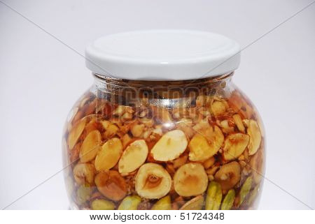 Jar Of Greek Honey And Nuts In Natural Light