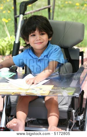 Disabled Child In Medical Stroller
