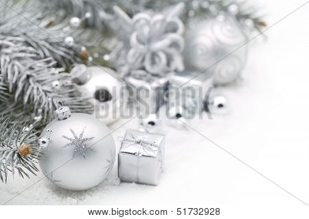 Christmas decoration with fir branch,silver Christmas ball and gift box