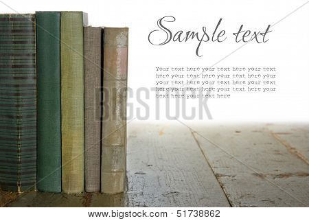 Green Old Books On Wooden Background