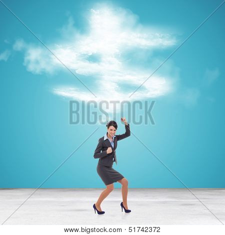 young business woman gesturing her success in front of a big dollar symbol made of couds