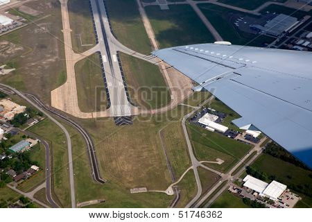 Airport landing road view from aerial view and aircraft wing