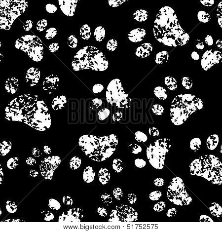 Paw footprints of a dog or a cat seamless pattern in black and white, vector