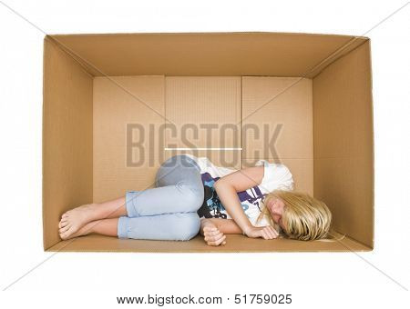 Woman sleeps in a cardboard box isolated on white background