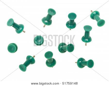 Green pushpins isolated on white background