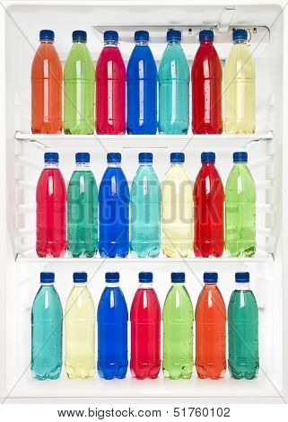 Bottles with different colors in a fridge