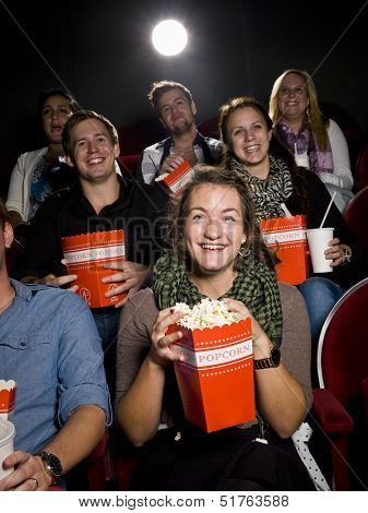 Spectators eating popcorn at the movie theater