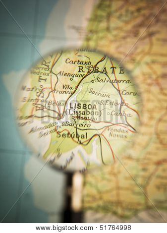Magnifying Glass in front of a Lisboa map