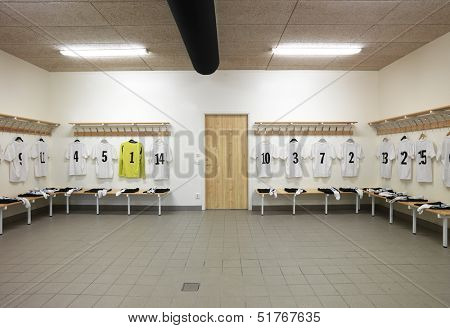 Soccer teams dressing room with numbered shirts