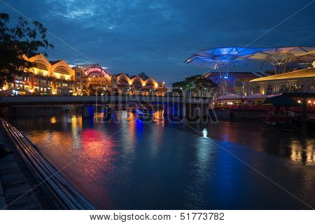 SINGAPORE - SEPTEMBER 16: Clarke Quay is a historical riverside quay in Singapore, by the Singapore River that attracts locals and tourist to its colorful nightlife. September 16, 2013 in Singapore.