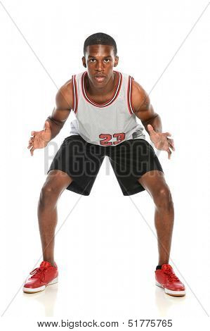 African American basketball player on defense isolated over white background
