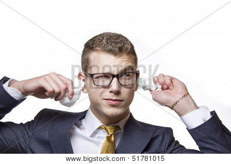 Young Businessman Cleaning His Ears With A Cotton Tissue