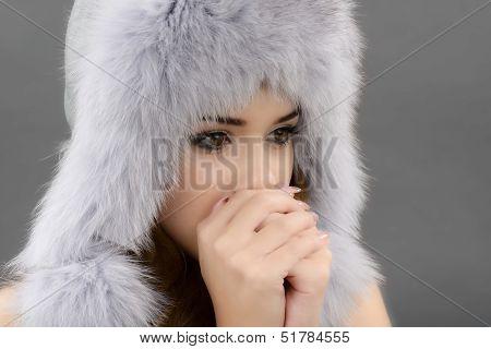 portrait of woman in fur cap