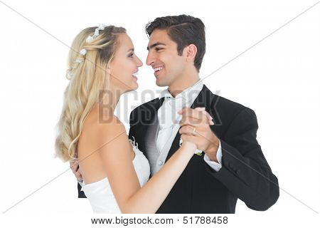 Sweet married couple dancing viennese waltz smiling at each other