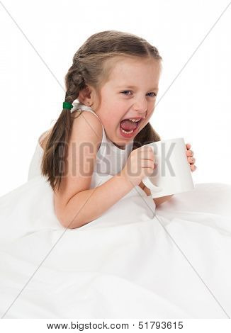 girl with cup cry in bed