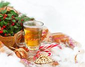 stock photo of blanket snow  - Christmas still life with a Christmas decorations and hot tea nestling in fresh snow - JPG
