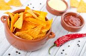 stock photo of table manners  - Tortilla chips with two different dips on a white table - JPG