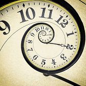 stock photo of hypnotizing  - Old vintage clock in the drost effect - JPG