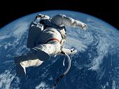 stock photo of orbital  - The astronaut  on the background of the planet - JPG