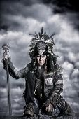 picture of shaman  - Portrait of a shaman dancing over cloudy sky - JPG