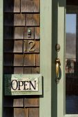 stock photo of cape-cod  - Open sign on the door of Rockport MA - JPG
