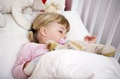 stock photo of goodnight  - Baby Girl in her bed - JPG