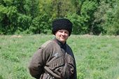 KIEV, UKRAINE -MAY 11: Member of Red Star history club wears historical uniform cossack of Corps von