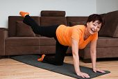Senior woman exercising at home