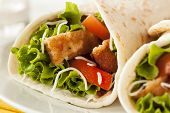 stock photo of tomato sandwich  - Breaded Chicken in a Tortilla Wrap with Lettuce and Tomato - JPG