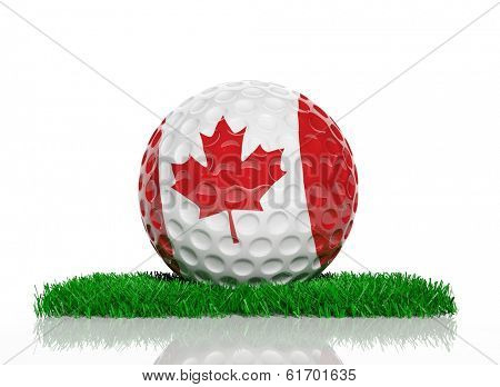 Golf ball with flag of Canada on green grass