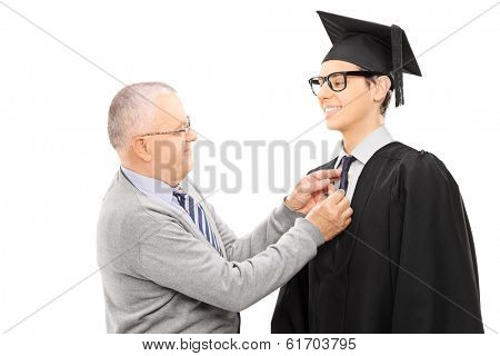 Proud father preparing his son for graduation isolated on white background