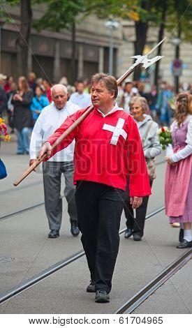 ZURICH - AUGUST 1: Swiss National Day parade on August 1, 2009 in Zurich, Switzerland. Representative of canton Schwyz in a historical costume.