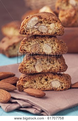 Cantuccini almond biscuits stacked on a brown background