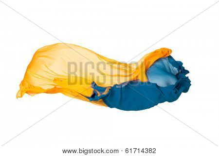 pieces of yellow and blue fabric flying, high-speed studio shot