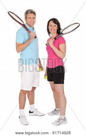 Mature Couple With Tennis Racquets