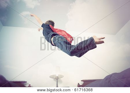 Super hero flying into imagination