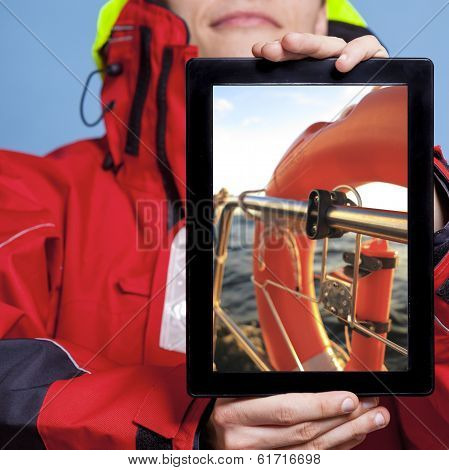 Man Sailor Showing Lifebuoy On Tablet. Sailing