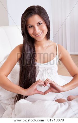 Pregnant Woman Making A Heart Sign